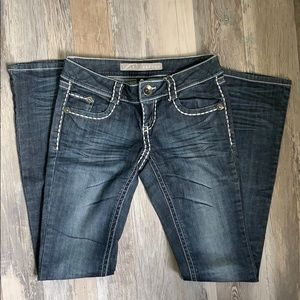 Refuge boot cut jean with white stitching